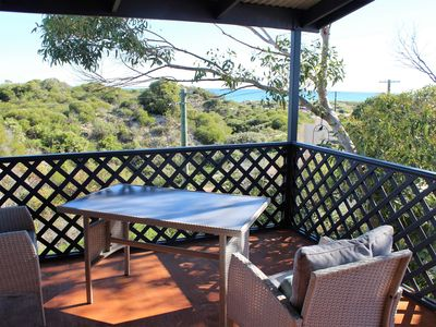 Outdoor setting on deck with spectacular views of the beach and dunes