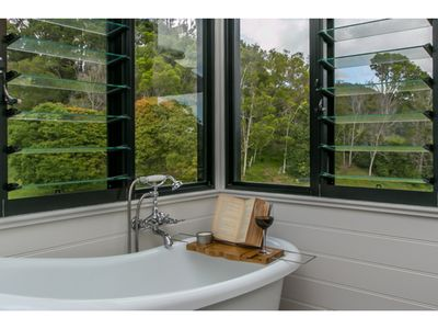 Ensuite bathtub for relaxing with a glass of wine and interesting book