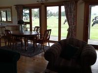 The dinning area looking out to the cows