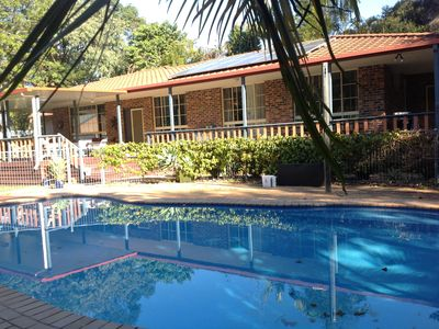 Exterior with pool and front verandah