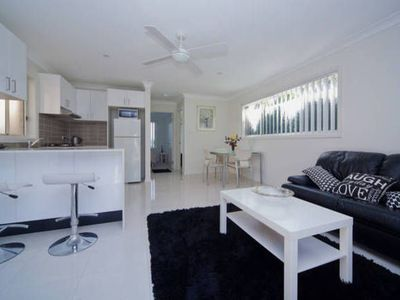 Spacious lounge and dining area with full kitchen.  Aircon and ceiling fans