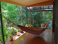 Guest relaxes in hammock