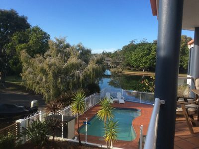 View of pool and canal from the balcony