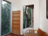 Bedroom with japanese screen and deck