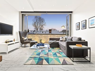 Bi-fold doors bring the living room to life with fantastic neighbourhood views.