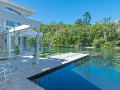 Pool view to nature reserve across the Noosa River