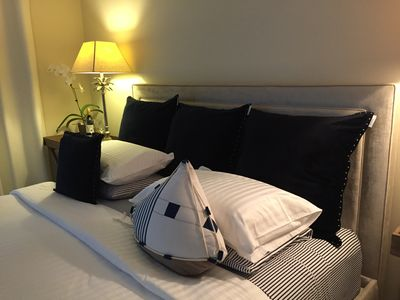 Luxury cotton linens and a king size upholstered bed