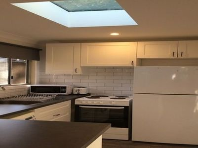 Fully service kitchen with refrigerator, stove, microwave & washing machine