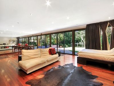 The enormous bedroom  with leather sofa and dining area.