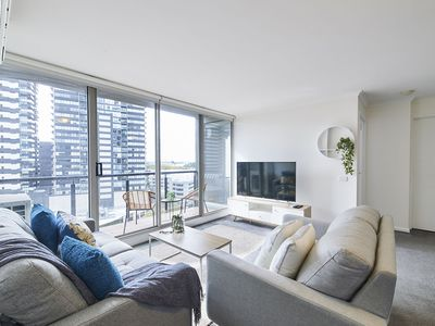 Living room and city view balcony