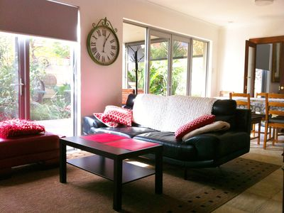 Open plan living area opens out to deck