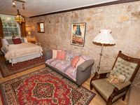 Room 5 offers double bed, extra lounge, extra tv and woodfire