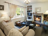 cosy up by the fireside in Gatehouse Cottage