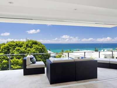 Covered balcony with outdoor lounge and stunning ocean views
