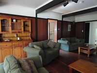 loungeroom with large screen TV, DVD and stereo system