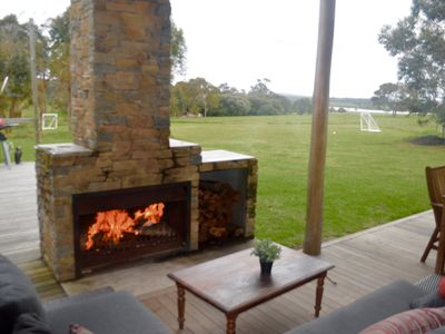 outside fireplace and rural views