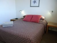 main bedroom queen bed: all Parramatta View Furnished Apartments
