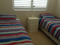 Spacious bedroom with two single beds