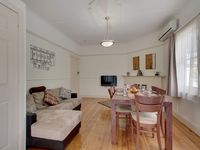 Comfortable family dining room with LCD TV and air conditioning