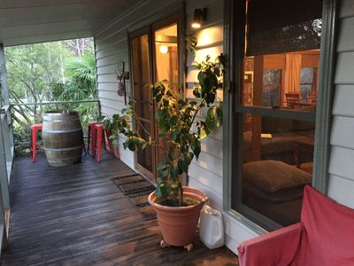 Enjoy a wine at the end of the day on the front verandah
