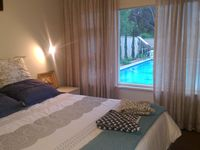 Down stairs bedroom overlooking the garden and pool
