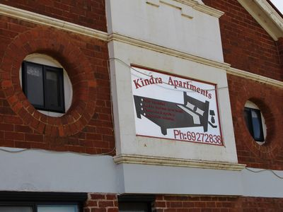 Kindra Apartments Sign